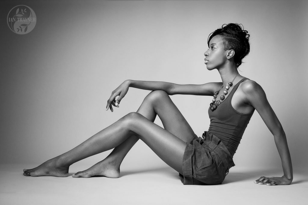 Simple and elegant monochrome photo of a slim black model. This image was taken on a model experience photo shoot.