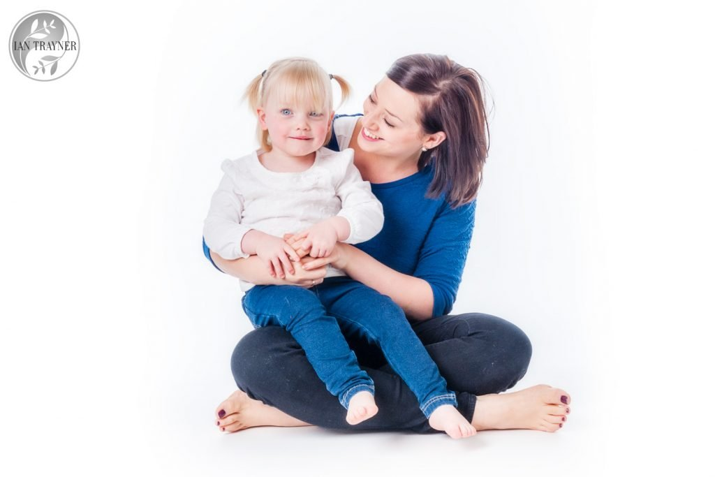 High key family photoraphy in the studio. Happy mother with daugher photo.