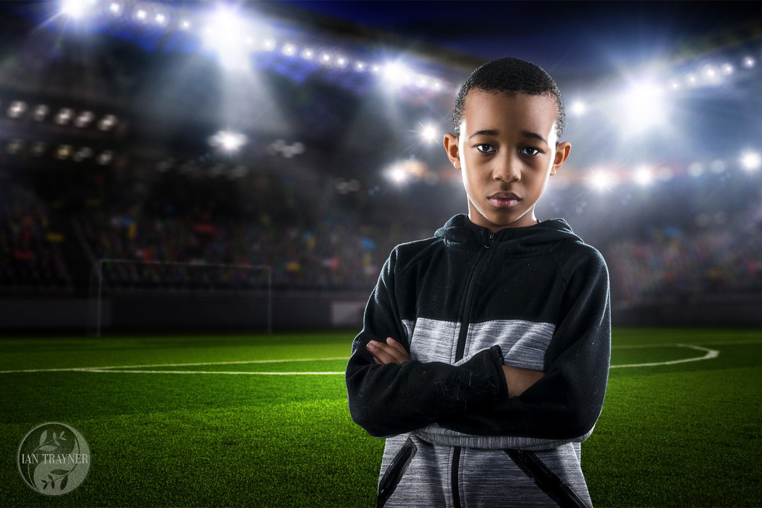 Creative family photography. Photo composite. Boy photographed in studio then inserted into a soccer stadium.