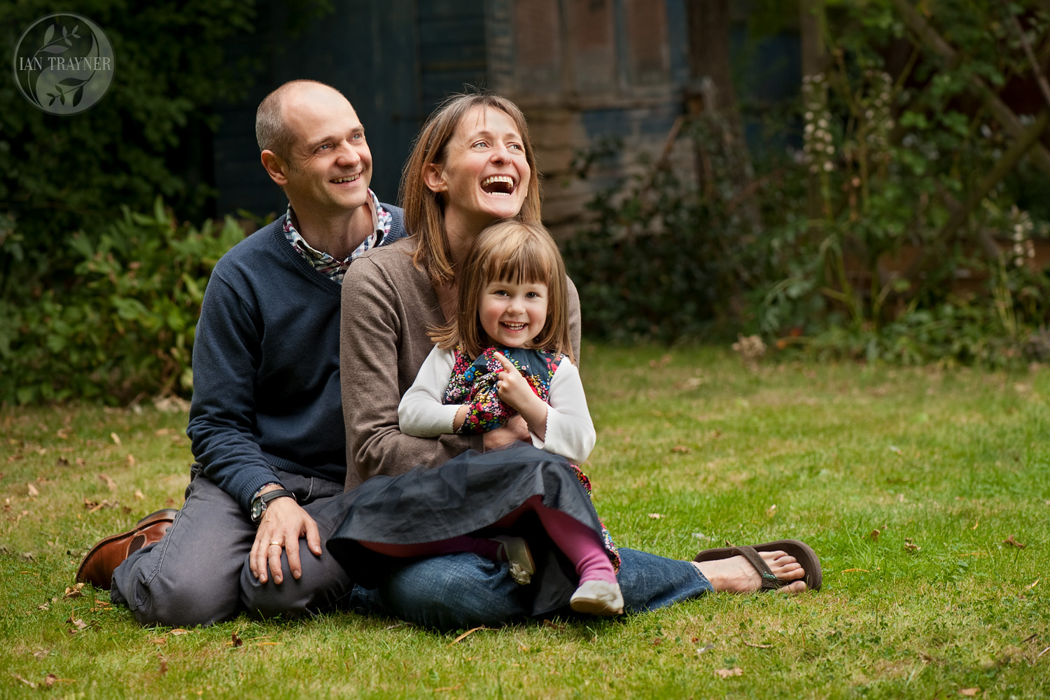 Happy family photography. Photo shoot in their garden.