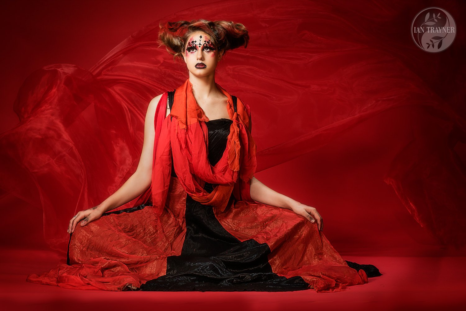 """Red on red"" Creative fashion photo shoot by Ian Trayner. Model is Cerys Wrigley Moss. Designer is Lind Blissett. Studio photo shoot in Kingston."