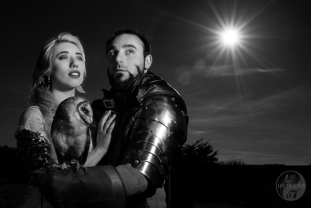 Knight with his Lady and an owl under the moon. Cosplay photo shoot with Ian Trayner.