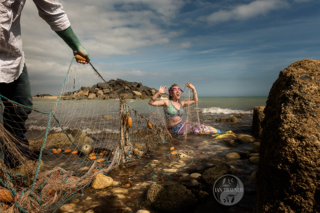 """Fisherman catches mermaid in his net"" fantasy photo shoot with Ian Trayner"