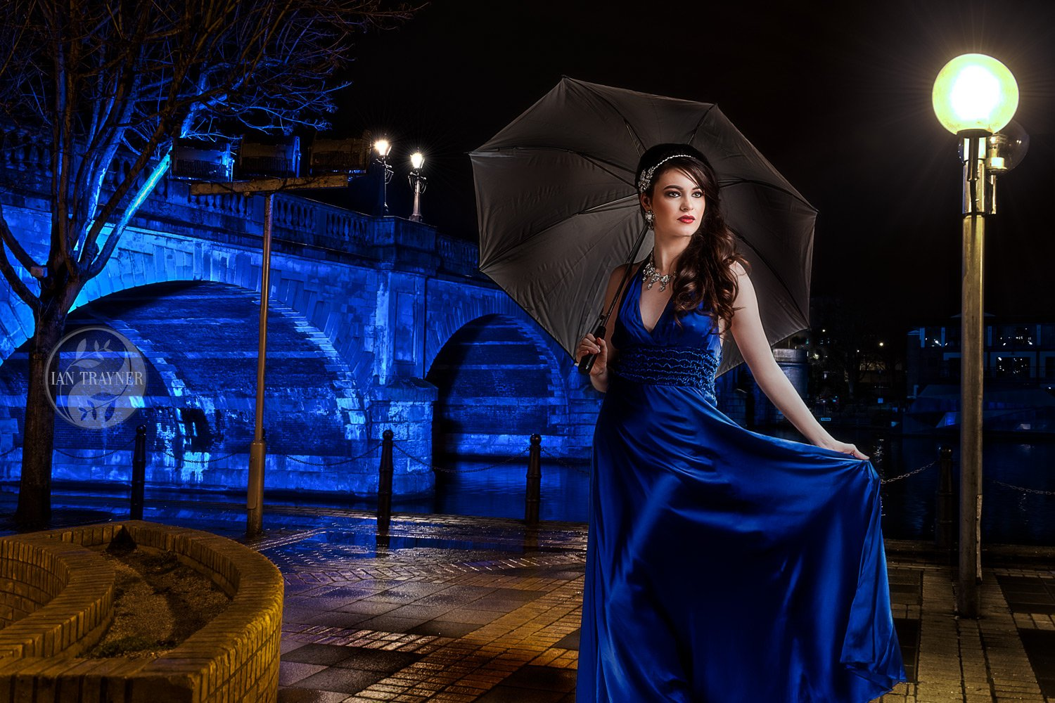 Portrait of Beauty Queen Rosemay Lloyd by Kingston Bridge at nightime. Kingston upon Thames.