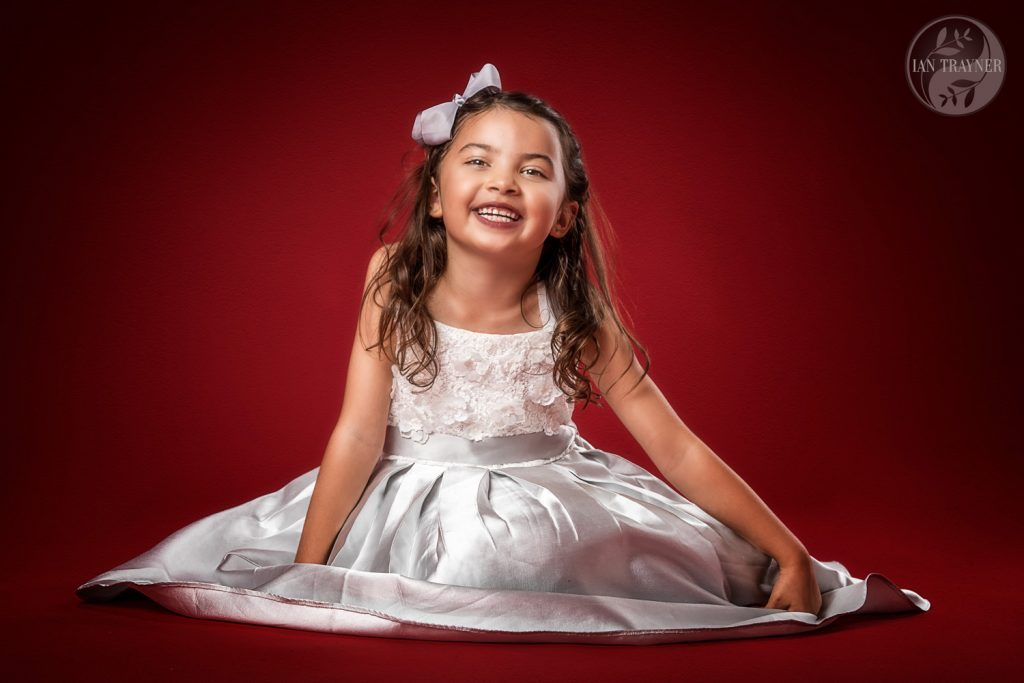 Very cute girl photographed in the studio. Family photography by Ian Trayner