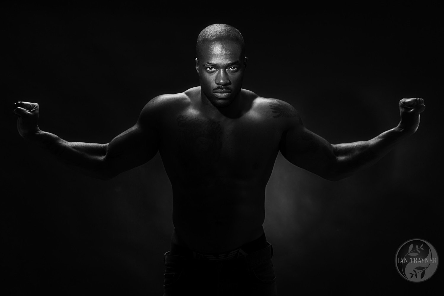 Creative and artistic photo portrait of actor and poet Adonis O'Holi, photographed in my studio in Kingston upon Thames. Photo noir. Male physique, athlete.