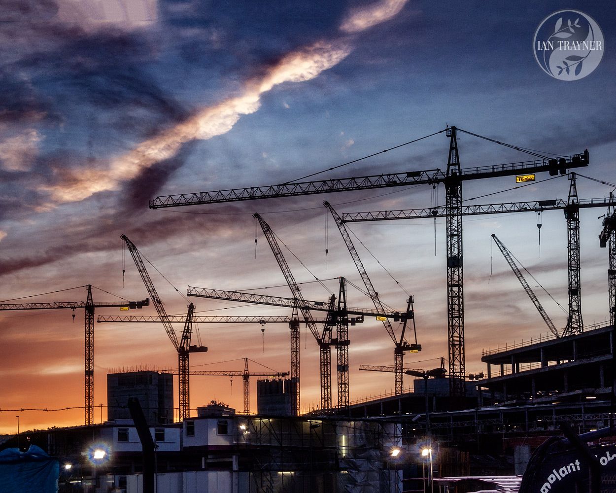 Sky and sunset. Cranes silhouetted against the evening sky. Westfield London in 2007. Photo by Ian Trayner.