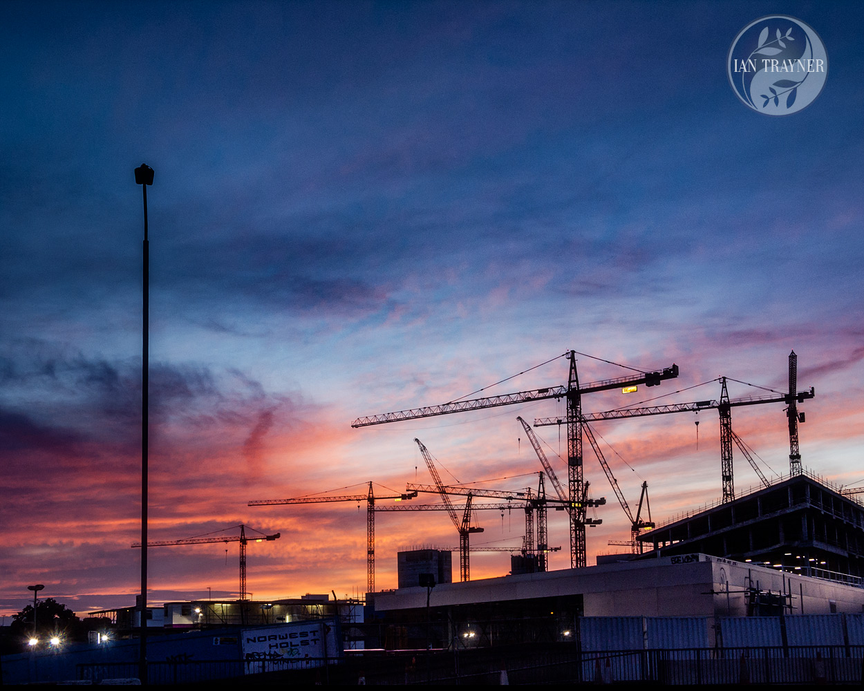 Dramatic sunset during construction of the Westfield London shopping centre in 2007. Photo by Ian Trayner.