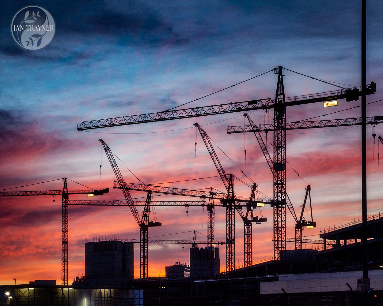 Sunset and cranes in silhouette. Photo taken by Ian Trayner in 2007 during construction of the Westsfield London shopping centre, Shepherd's Bush, London.