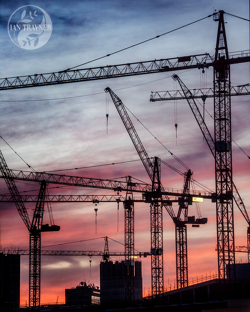 Photo of cranes at sunset. Building the Westfield London shopping centre in Shepherd's Bush in 2007. Photo by Ian Trayner.
