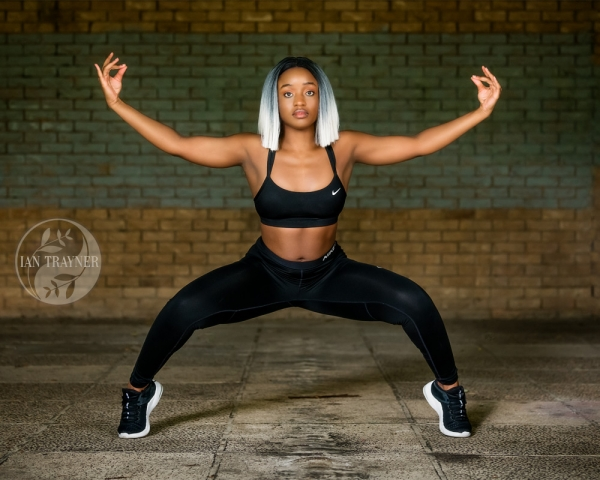 """Fitness photo shoot. """"Strength and balance"""". Beautiful young black fitness model Yolland Musa demonstraing exersizes for leg strength and balance. Photographer by Ian Trayner using natural light. Hair by Precious Muir Collection."""