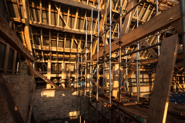 Mix of modern scaffolding and old wood, as the barn is renovated with the application of honest labour.