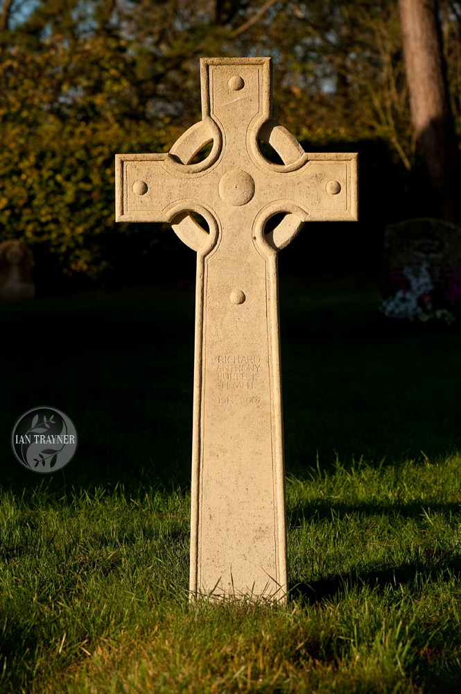 Celtic cross gravestone designed and carved by Ross Fuller, photo by Ian Trayner, direct sunlight