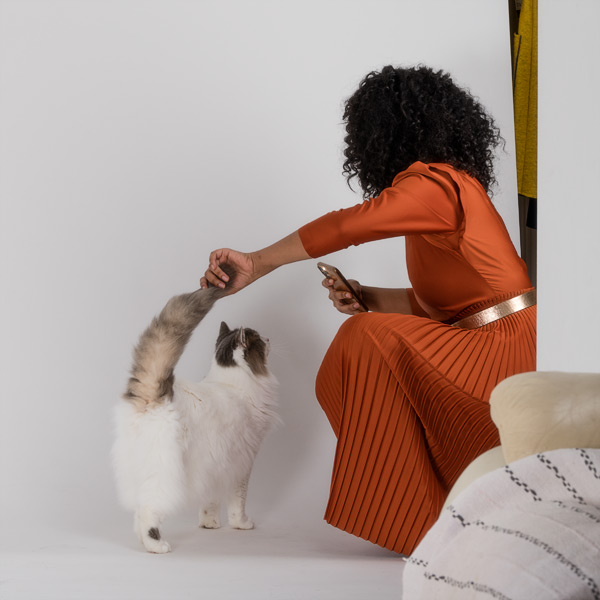 Model Delina Cleo with one of the studio cats