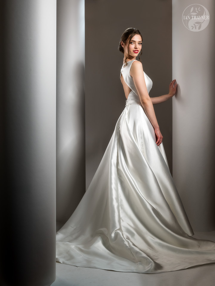 """Erika Sviderskyte wearing bridal gown """"Grace"""" by Shamali. From her 2021 """"Divine"""" collection. Photo by Ian Trayner. Hollywood style lighting."""