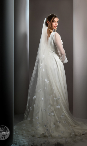 """Bridal gown """"Monroe"""" worn by Erika Sviderskyte. From Shamali's 2021 collection """"Divine"""". Photo by Ian Trayne . Hollywood lighting."""